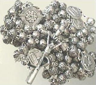 Rose Bead Metal Rosary on a Mirror